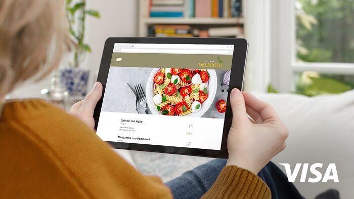 frau-tablet-onlinebestellung-visa