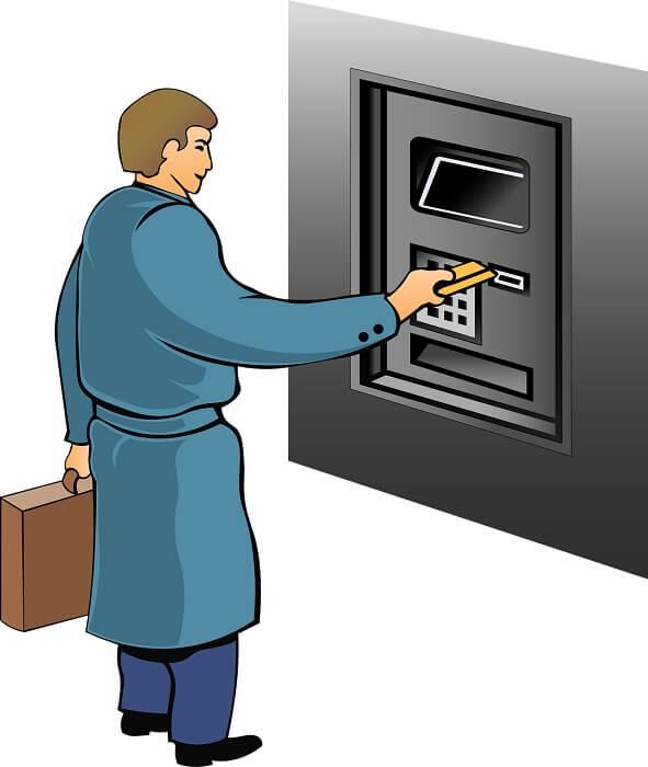 mann-bankkarte-geldautomat